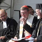 Kardinal Woelki mit Präses und Metropolit an seiner Seite..
