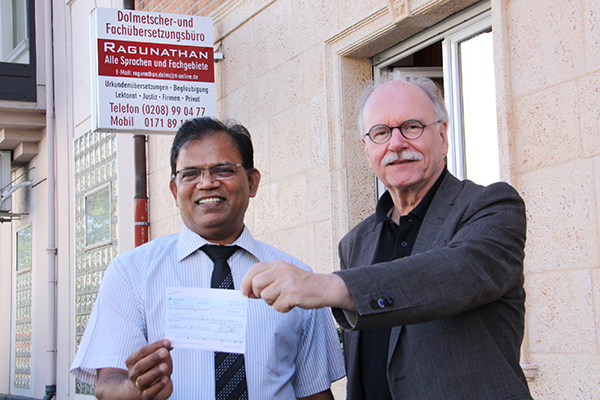 Übersetzer Ayadurai Ragunathan und Superintendent Helmut Hitzbleck