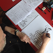 Visual Recording: Cartoonist Michael Hüter zeichnet live bei der Tagung