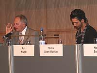 Auf dem Podium des Kirchentags im Juni in Köln: Aziz Kruezi (r.) mit Innenminister Schäuble.
